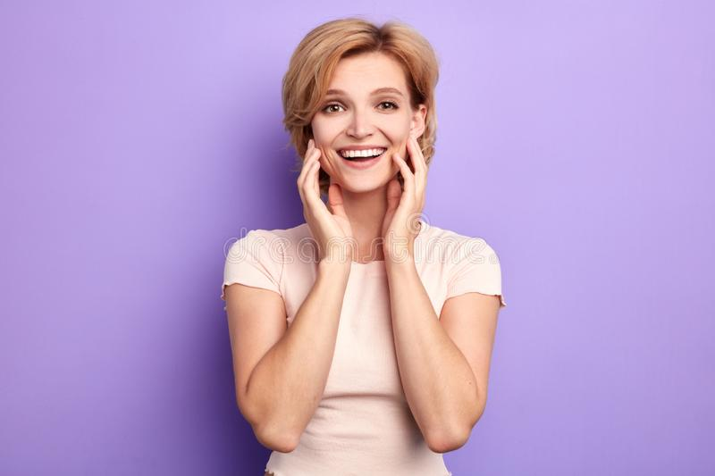 Beautiful positive charming woman enjoys her skin royalty free stock photography