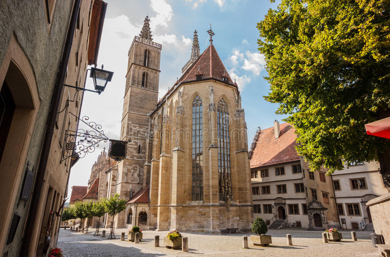 Beautiful postcard day view of St. Jakob or St. James Church or St. Jakob Kirche, Rothenburg ob der Tauber, Germany. One of the favorite`s attraction of royalty free stock photos