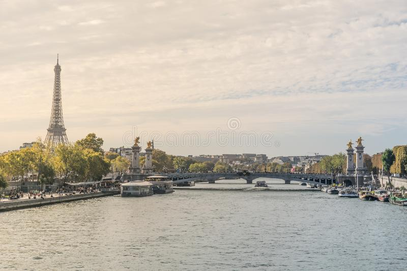 Beautiful postcard view of the Seine river crossing the Paris city in France, with tourist attraction boats in the. Margins at the eiffel tower and the stock photography