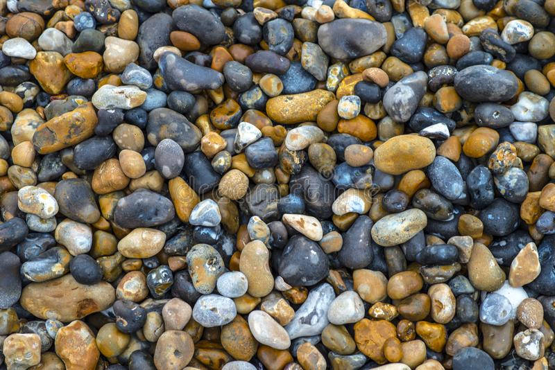 A Background Image Of Beach Stones In East Sussex England Stock
