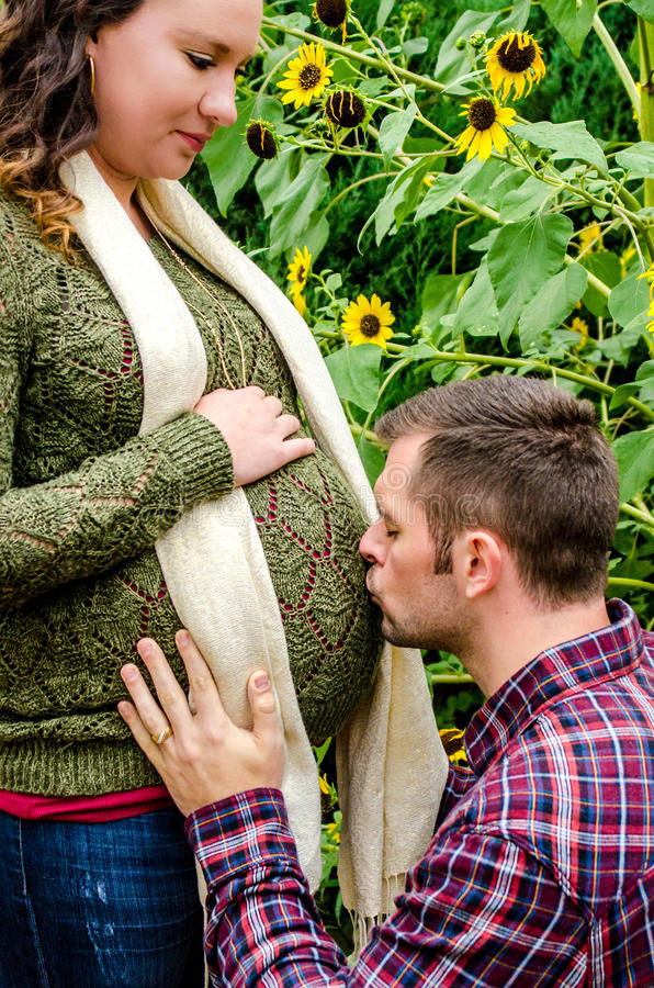 Beautiful pregnant couple stock photo
