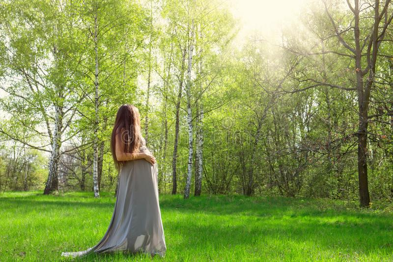 Pregnant woman on a meadow royalty free stock photo
