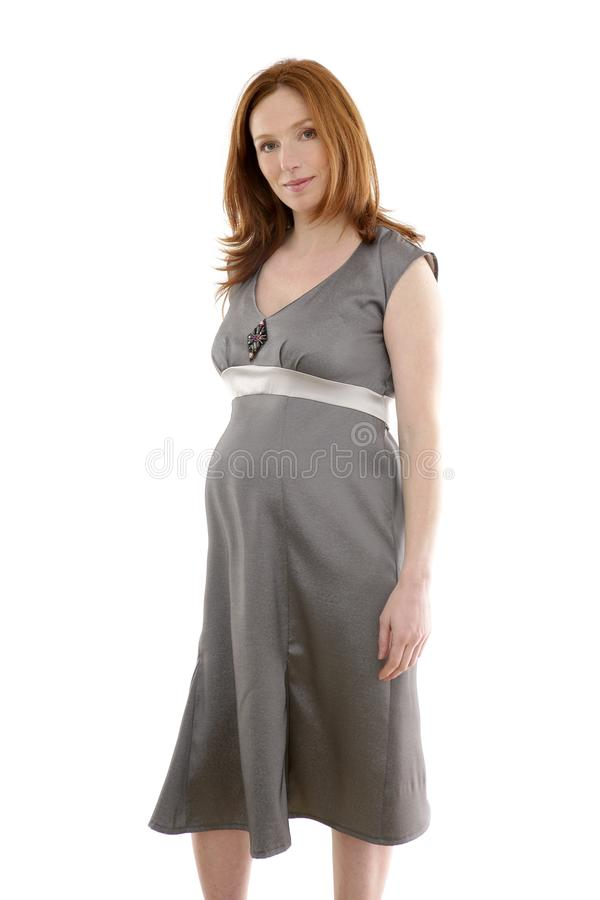 Beautiful pregnant redhead woman fashion royalty free stock images