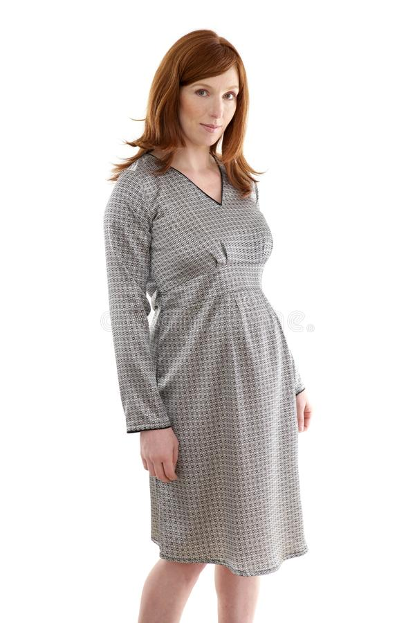 Beautiful pregnant redhead woman fashion stock photo