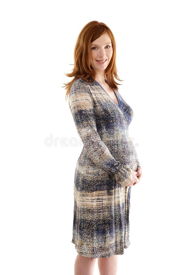 Beautiful pregnant redhead woman fashion stock photos
