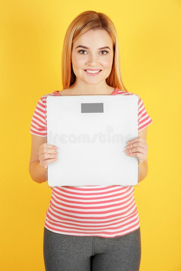 Beautiful pregnant woman holding scales stock images