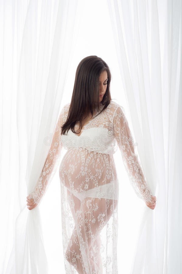 Free Beautiful Pregnant Woman In A White Lace Gown Royalty Free Stock Photos - 90102528
