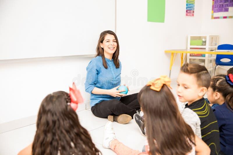 Beautiful preschool teacher at work royalty free stock images