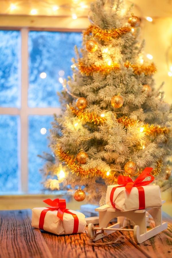 Beautiful presents and Christmas tree in old rustic house stock images