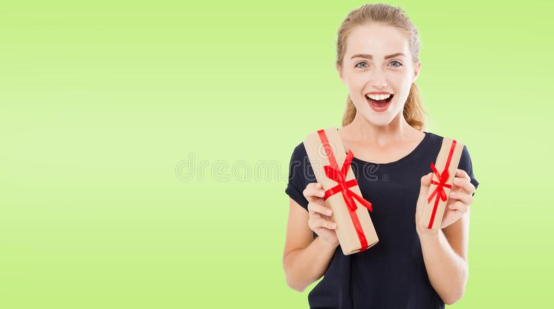 Beautiful pretty casual caucasian girl holding presents in boxes, holidays royalty free stock photo