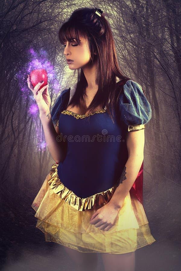 Beautiful princess holding a magic apple. Beautiful princess in the woods holding a magic apple stock photos