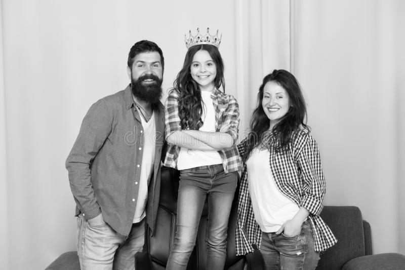 Beautiful princess. Little girl love her parents at home. Bearded man and woman with princess daughter. Father, mother royalty free stock images