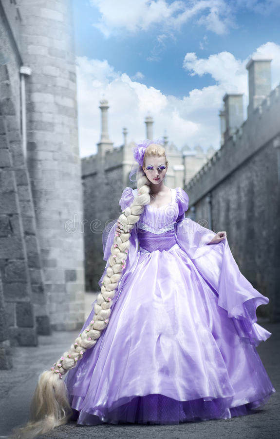 The beautiful princess with a long plait royalty free stock image