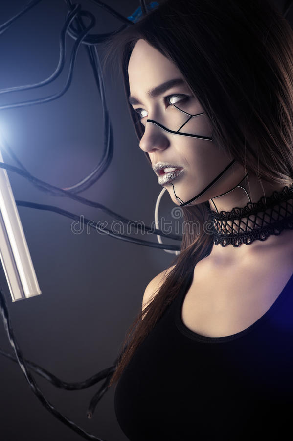 Beautiful profile face robot girl in style cyberpunk with wires royalty free stock photos