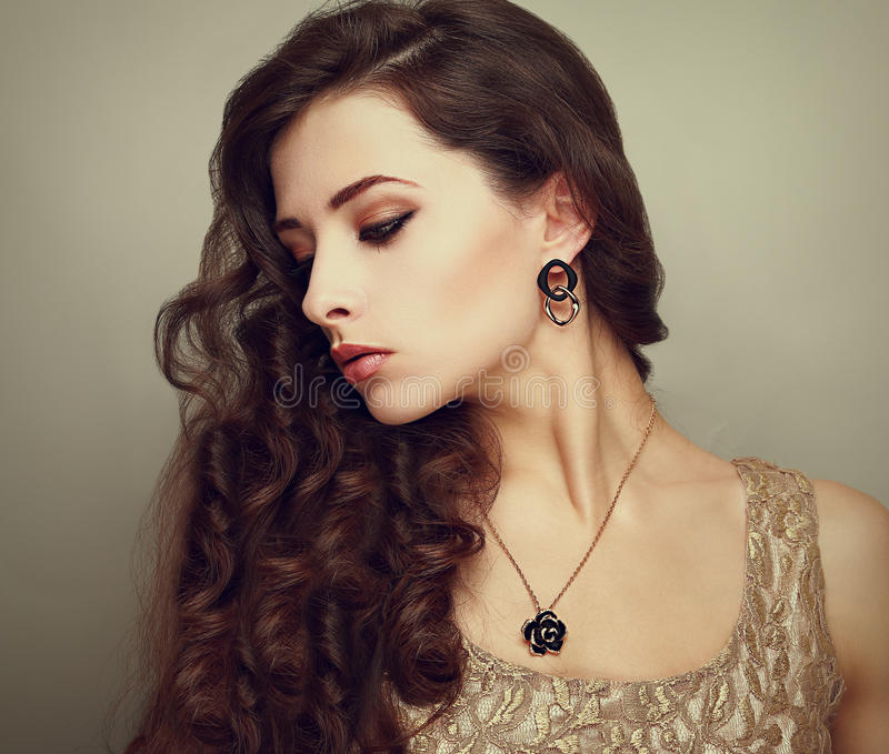 Beautiful profile of female model looking down royalty free stock photos