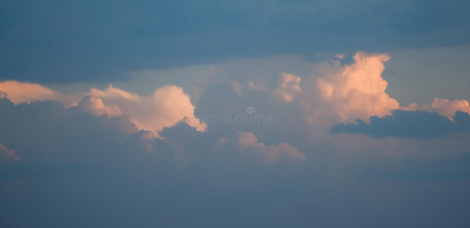Extra Puffy Cumulus Clouds in the Evening Sun. Beautiful puffy cumulus clouds are displayed in this image contrasting nicely with a blue sky royalty free stock photos