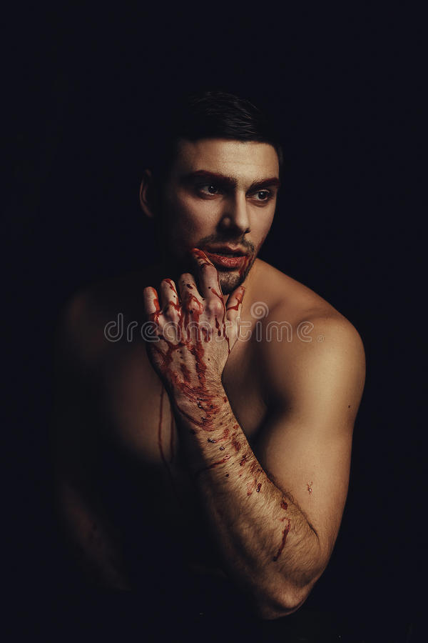 Beautiful vampire man. Male after fight royalty free stock images