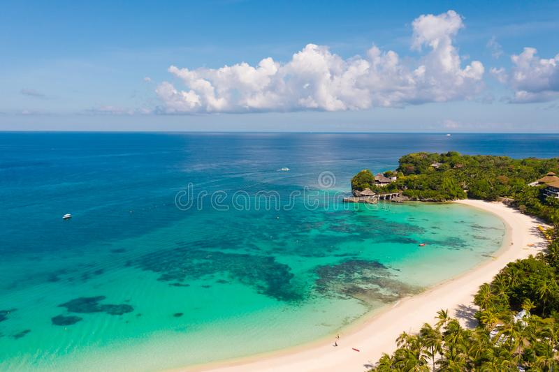 Beautiful Punta Bunga Beach on Boracay island, Philippines. White sandy beach and beautiful lagoon with coral reefs. The coast of the island of Boracay for stock photos