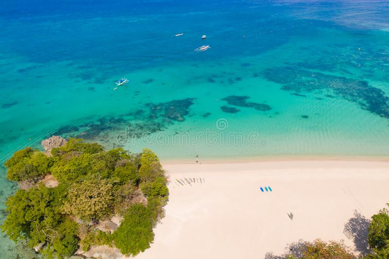 Beautiful Punta Bunga Beach on Boracay island, Philippines. White sandy beach and beautiful lagoon with coral reefs. The coast of the island of Boracay for royalty free stock images