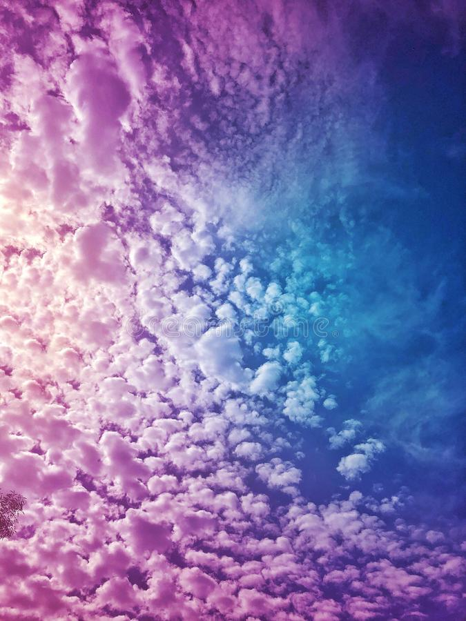 Beautiful Purple fluffy Clouds in sky royalty free stock images
