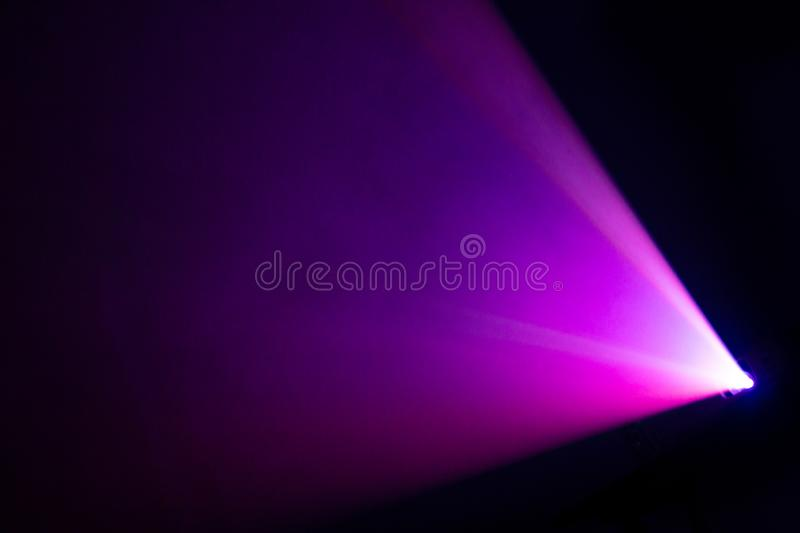 Beautiful purple pantone color wide lens projector spotlight . smoke abstract texture background . screening for multimedia royalty free stock photo
