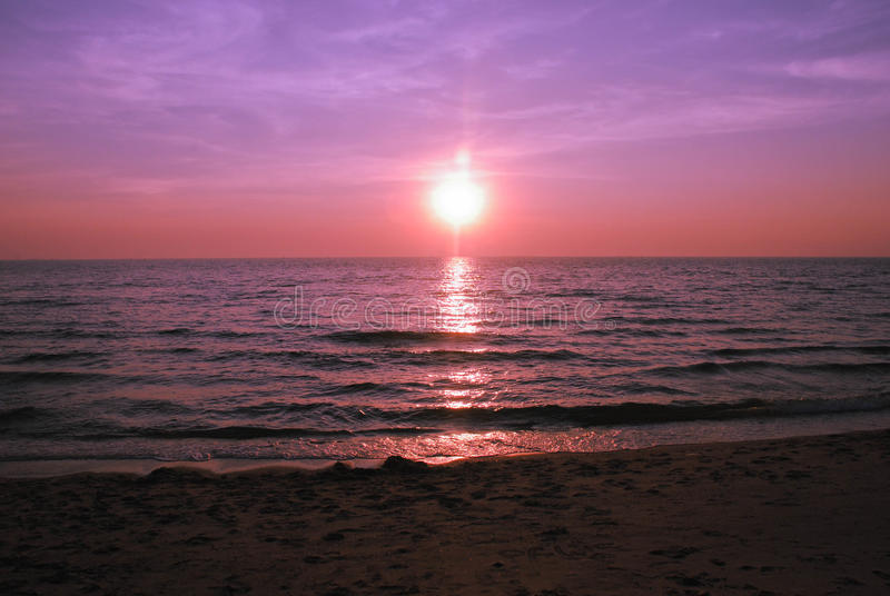Beautiful purple sunset Burning Skies over the sea stock images