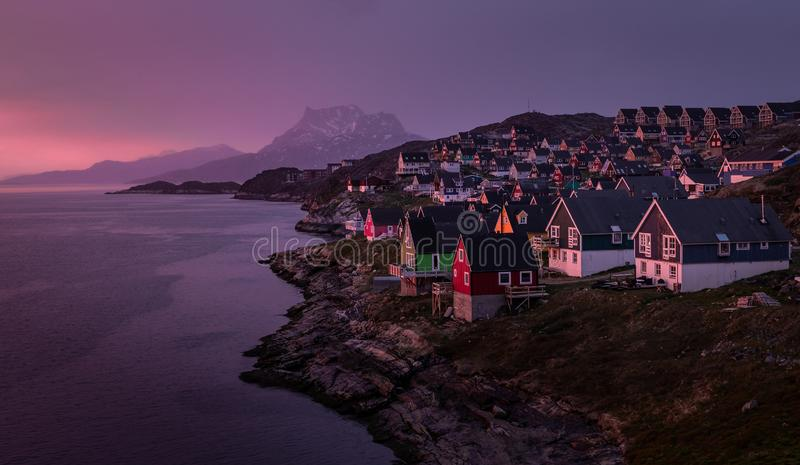 Nuuk, Capital of Greenland. Beautiful purple sunset in Nuuk, Capital of Greenland. With Sermitsiaq mountain in the background royalty free stock image