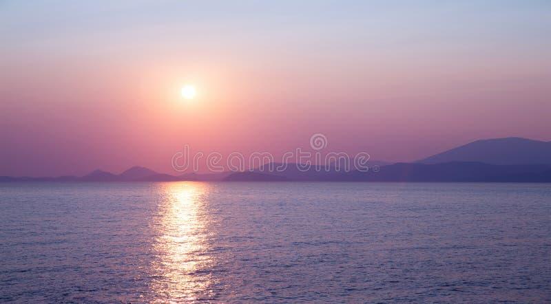 Beautiful purple sunset. On the sea, sun reflection on peaceful water, wonderful landscape, scene destination, beauty of nature concept royalty free stock photography