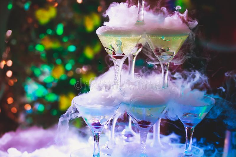 Beautiful pyramid line of different coloured alcohol cocktails with mint on christmas party, tequila, martini, vodka, and others o royalty free stock photo
