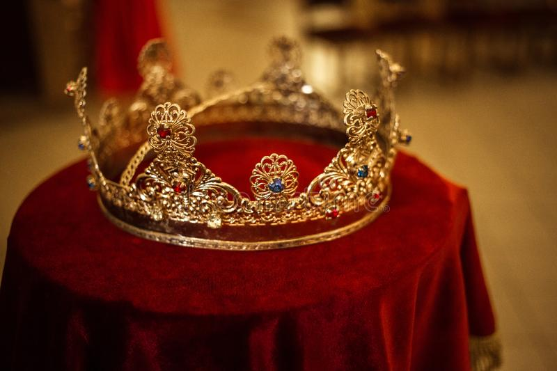 Beautiful queen king crown fantasy medieval period wedding crown. Wedding crown in yellow and red in the church stock photography