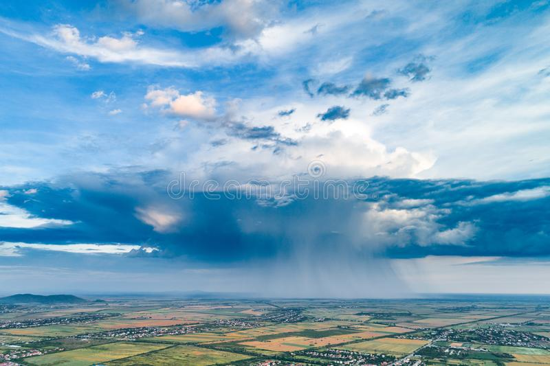Beautiful rain cloud and rain over the fields. Aerial photography stock images
