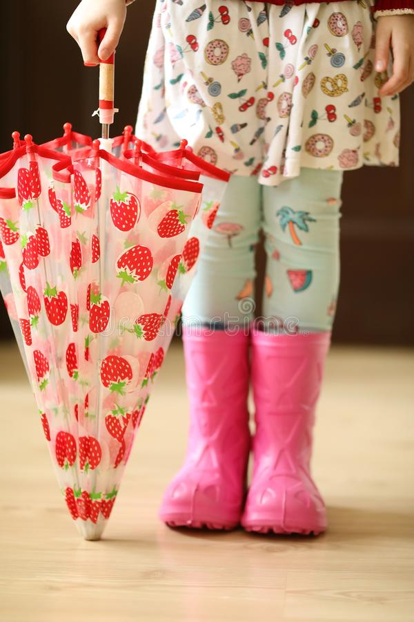 Beautiful Rainboots And Children With Umbrellas Colorful Fancy Wear In  Summer Day
