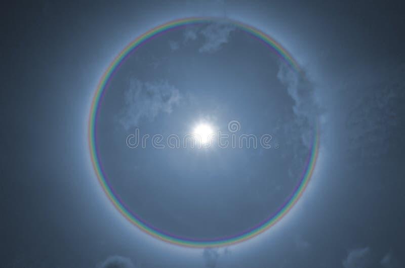 Beautiful rainbow ring of sun halo phenomenon. In the blue summer sky stock images