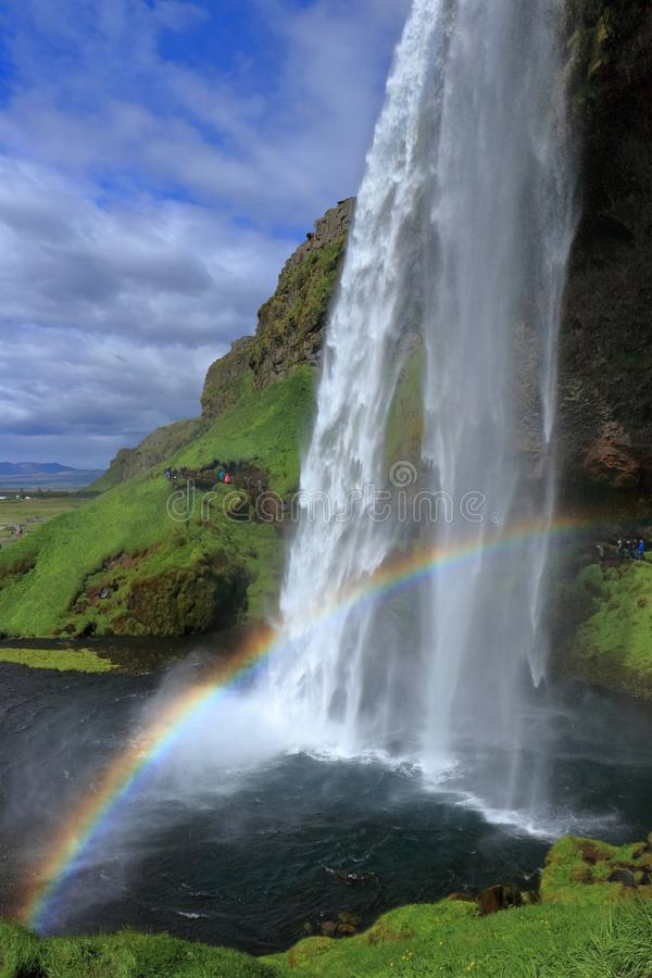 Beautiful Rainbow at Seljalandsfoss, South Coast of Iceland. The spray of Seljalandsfoss creates a beautiful rainbow at its base that contrasts nicely with the stock photography