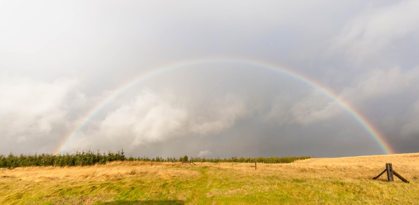 Rainbow. A beautiful rainbow on top of the mountain royalty free stock photography