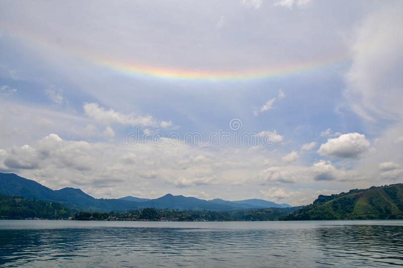 Beautiful Rainbow and view of Lake Toba. This view from Samosir Island, North Sumatra, Indonesia stock photo
