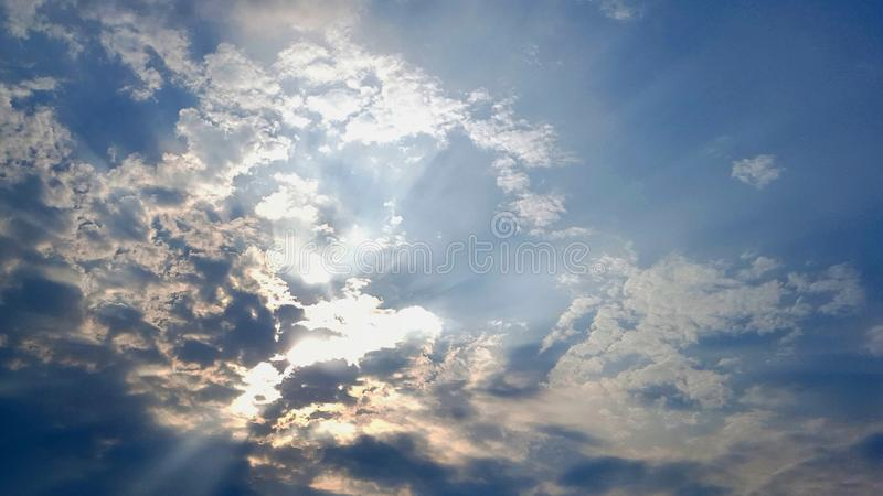 Beautiful rays of light through the clouds. The Beautiful rays of light through the clouds royalty free stock images
