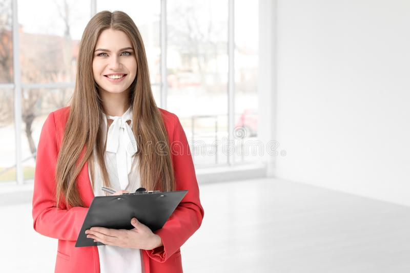 Beautiful real estate agent with clipboard royalty free stock photography