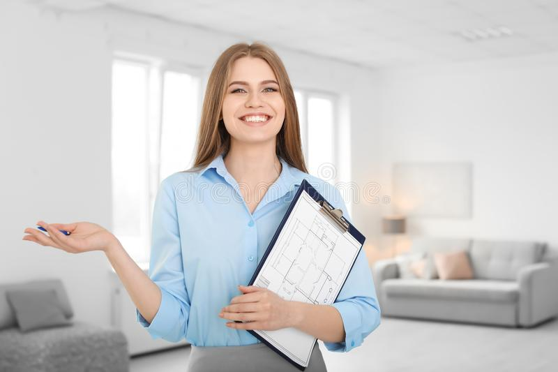 Beautiful real estate agent with clipboard stock photography