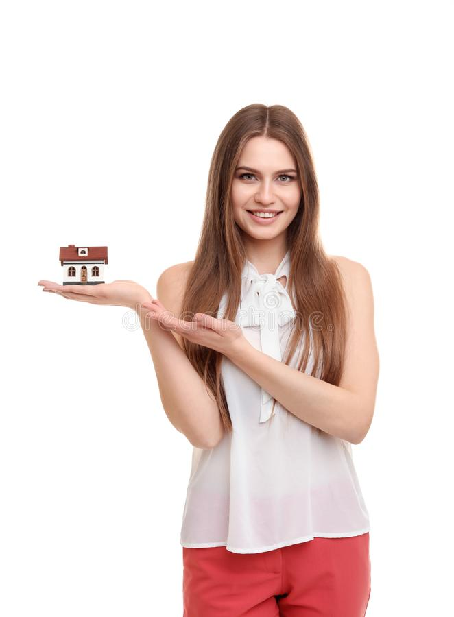 Beautiful real estate agent with house model stock photography