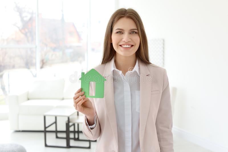 Beautiful real estate agent with house model royalty free stock images