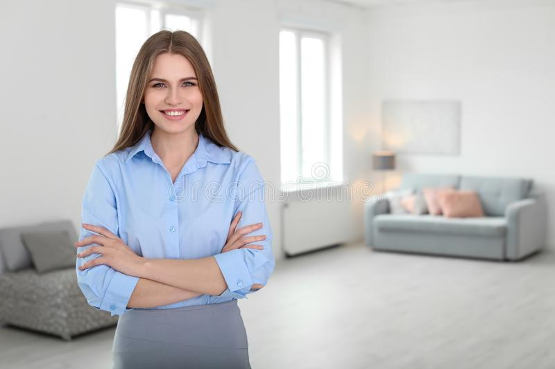 Beautiful real estate agent. Indoors stock photography