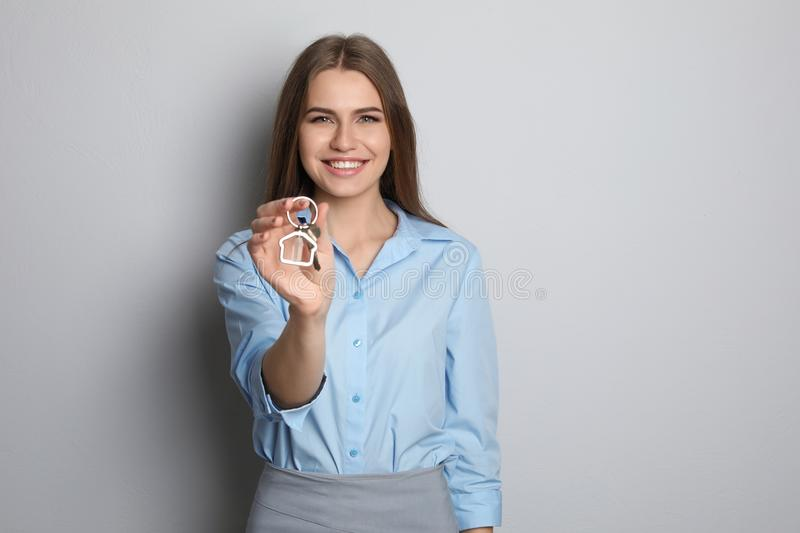 Beautiful real estate agent with key stock photography