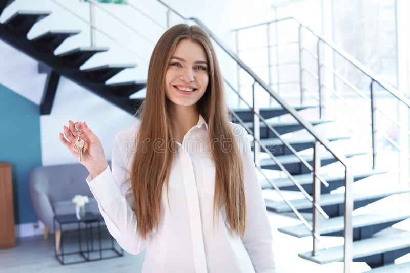 Beautiful real estate agent with key stock photos