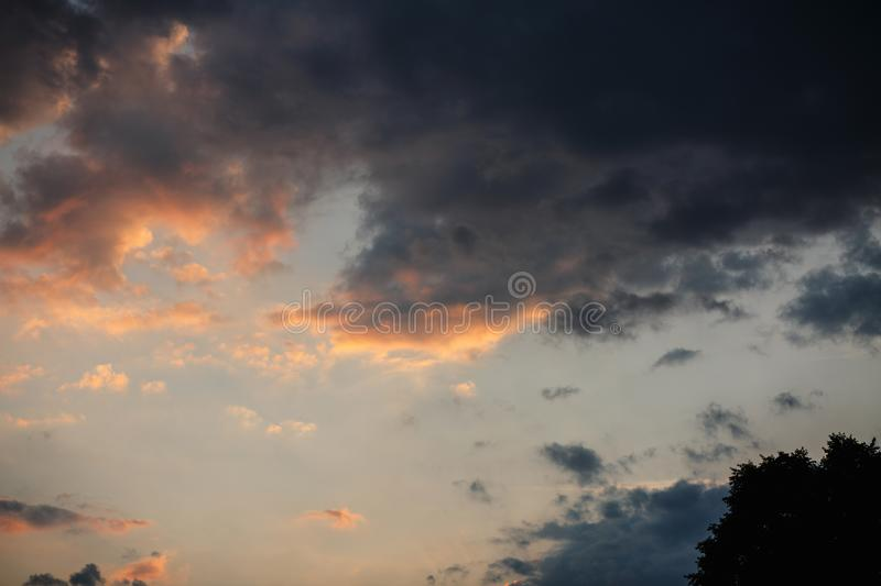 Beautiful sunset sky with bright transitions in color. Beautiful realistic sunset sky with bright transitions in color, splendid screensaver. Sunlight royalty free stock photos