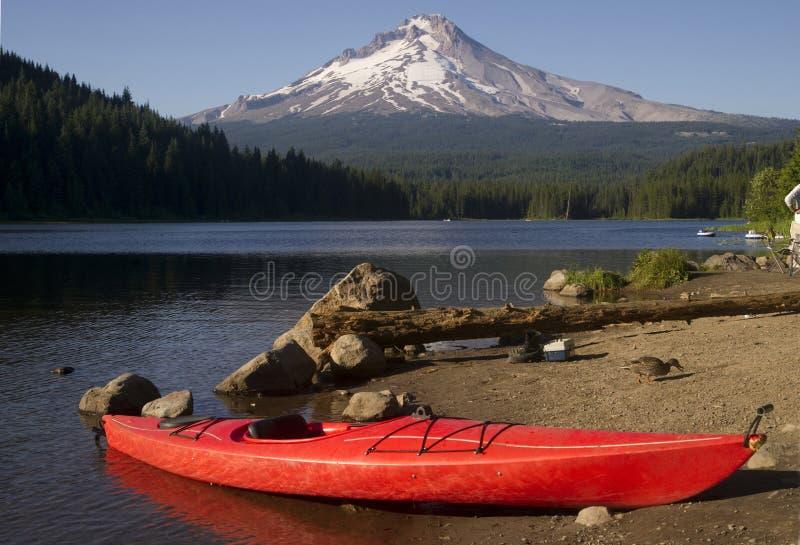 Single Red Kayak on Shore Trillium Lake Mount Hood Oregon stock photos