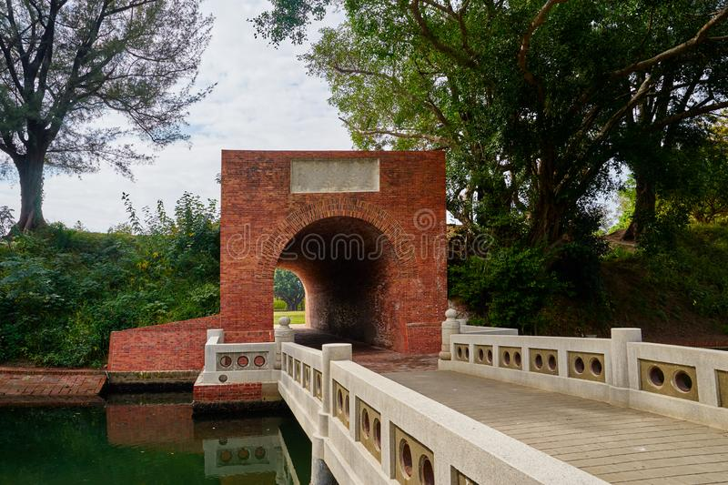 Beautiful red brick tunnel scenic of the Eternal golden castle. Ruins of a defensive castle built with cannon in Tainan city, Taiwan royalty free stock photo