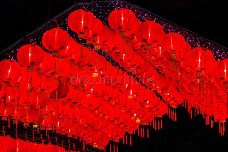 Beautiful red Chinese lantern on the night during new year festival with the Chinese character Blessings written on it. stock photography