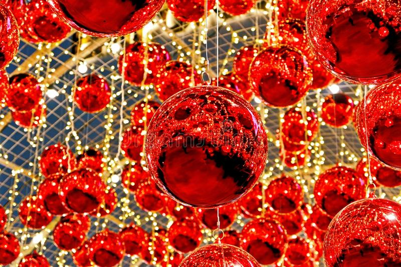 The Beautiful Red Christmas Balls. Closeup Photo of the Beautiful Red Christmas Balls Hanging Outside the Building stock photo
