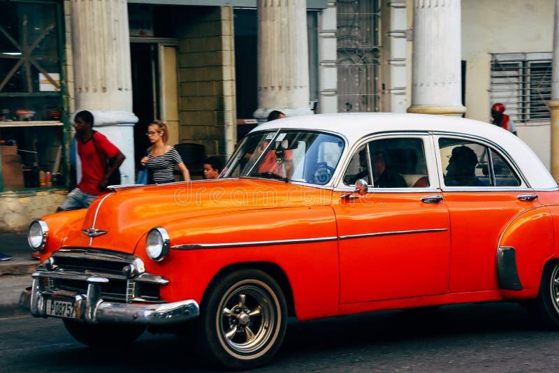 A beautiful red classic car in Havana city, Cuba. stock images